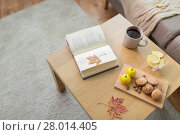 Купить «book, lemon, tea and cookies on table at home», фото № 28014405, снято 15 ноября 2017 г. (c) Syda Productions / Фотобанк Лори