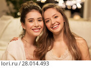 Купить «happy female friends hugging», фото № 28014493, снято 21 января 2018 г. (c) Syda Productions / Фотобанк Лори
