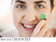 Купить «close up of happy young woman face with shamrock», фото № 28014553, снято 31 января 2018 г. (c) Syda Productions / Фотобанк Лори