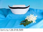 Купить «Hat nurse white and Millingtonia hortensis flowers», фото № 28018589, снято 19 марта 2019 г. (c) PantherMedia / Фотобанк Лори
