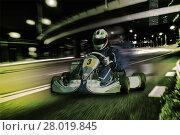 Купить «Karting - driver in helmet on kart circuit», фото № 28019845, снято 24 мая 2018 г. (c) PantherMedia / Фотобанк Лори