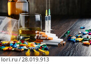 Купить «addictive substances, including alcohol, cigarettes and drugs», фото № 28019913, снято 18 октября 2019 г. (c) PantherMedia / Фотобанк Лори