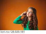 Купить «The cute cheerful little girl on orange background», фото № 28020181, снято 27 июня 2019 г. (c) PantherMedia / Фотобанк Лори