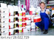 Купить «seller picking paint in store», фото № 28022729, снято 20 июля 2019 г. (c) Яков Филимонов / Фотобанк Лори