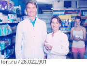 Купить «Portrait of happy man and woman pharmacists», фото № 28022901, снято 15 ноября 2018 г. (c) Яков Филимонов / Фотобанк Лори