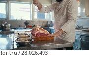 Купить «Butcher adding spices into large piece of fresh raw meat lying on a wooden board in a commercial kitchen, slow motion», видеоролик № 28026493, снято 23 июля 2019 г. (c) Константин Шишкин / Фотобанк Лори