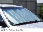 Купить «Sun Reflector windscreen. Protection of the car panel from direct sunlight.», фото № 28042397, снято 22 марта 2019 г. (c) PantherMedia / Фотобанк Лори