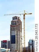 Купить «Crane on a construction site. Construction of a skyscraper», фото № 28043173, снято 17 февраля 2018 г. (c) Евгений Ткачёв / Фотобанк Лори