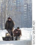 Купить «Compact snowmobile for hunting - motorcycle towing pulls two hunters at sunny winter countryside», фото № 28047421, снято 17 февраля 2018 г. (c) Константин Шишкин / Фотобанк Лори