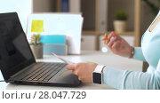 Купить «woman with laptop working on user interface design», видеоролик № 28047729, снято 10 февраля 2018 г. (c) Syda Productions / Фотобанк Лори