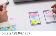 Купить «woman working on smartphone interface design», видеоролик № 28047737, снято 10 февраля 2018 г. (c) Syda Productions / Фотобанк Лори