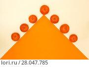 Купить «Абстрактный натюрморт с мандаринами и оранжевым треугольником», фото № 28047785, снято 17 февраля 2018 г. (c) V.Ivantsov / Фотобанк Лори