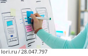 Купить «woman working on user interface design at office», видеоролик № 28047797, снято 10 февраля 2018 г. (c) Syda Productions / Фотобанк Лори
