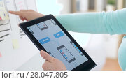 Купить «woman working on tablet pc interface design», видеоролик № 28047805, снято 10 февраля 2018 г. (c) Syda Productions / Фотобанк Лори