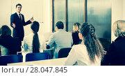 Купить «Professor and professionals at courses», фото № 28047845, снято 17 декабря 2018 г. (c) Яков Филимонов / Фотобанк Лори