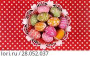 Купить «Rotating Easter eggs in basket, the red tablecloth as background», видеоролик № 28052037, снято 3 мая 2016 г. (c) Алексей Кузнецов / Фотобанк Лори