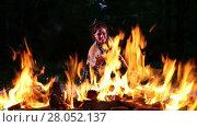 Купить «Pretty young woman performing fire dance outdoors», видеоролик № 28052137, снято 13 июня 2016 г. (c) Алексей Кузнецов / Фотобанк Лори