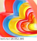 Купить «Абстрактный яркий детский разноцветный радужный квадратный бежевый фон с волнистыми линиями разных оттенков в форме сердца», фото № 28052385, снято 18 февраля 2018 г. (c) Светлана Евграфова / Фотобанк Лори