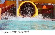 Купить «Children sliding on water slide in water park», видеоролик № 28059221, снято 2 июля 2014 г. (c) Алексей Кузнецов / Фотобанк Лори