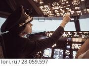 Female pilot captain prepares for take-off plane. Стоковое фото, фотограф Ekaterina Demidova / Фотобанк Лори