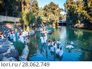 Купить «Christian pilgrims enter Jordan River waters», фото № 28062749, снято 20 января 2019 г. (c) easy Fotostock / Фотобанк Лори