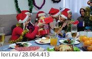 Купить «Portrait of happy family who is satisfied of presents in time celebration New Year at home.», видеоролик № 28064413, снято 17 января 2018 г. (c) Яков Филимонов / Фотобанк Лори