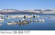 Купить «Panoramic view of floating icebergs in the glacial lake Jokulsarlon in Iceland», видеоролик № 28068117, снято 6 октября 2017 г. (c) Алексей Кузнецов / Фотобанк Лори