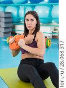 Купить «Young woman at the exercising gym», фото № 28068317, снято 18 февраля 2018 г. (c) Владимир Мельников / Фотобанк Лори
