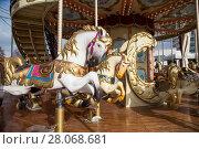 Купить «Old classic French vintage carousel horse in a holiday park (close up). Merry-go-round with horses», фото № 28068681, снято 22 февраля 2018 г. (c) Владимир Журавлев / Фотобанк Лори