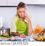 Купить «Sad girl with banking statement at home», фото № 28070525, снято 18 ноября 2018 г. (c) Яков Филимонов / Фотобанк Лори