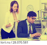 Купить «Businesswoman seducing male colleague», фото № 28070581, снято 1 июня 2017 г. (c) Яков Филимонов / Фотобанк Лори