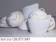 Купить «Кондитерские изделия, еда, десерт. Белый сладкий зефир на светлом фоне. Confectionery, food, dessert. White sweet marshmallows on a light background», фото № 28071041, снято 18 февраля 2018 г. (c) Светлана Евграфова / Фотобанк Лори