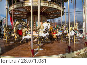 Купить «Old classic French vintage carousel in a holiday park. Moscow, Russia», фото № 28071081, снято 22 февраля 2018 г. (c) Владимир Журавлев / Фотобанк Лори