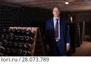Купить «Professional winemaker in wine cellar», фото № 28073789, снято 22 января 2018 г. (c) Яков Филимонов / Фотобанк Лори