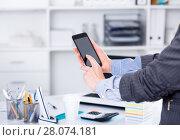 Купить «Businesswoman using smartphone», фото № 28074181, снято 20 апреля 2017 г. (c) Яков Филимонов / Фотобанк Лори