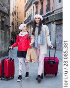 Купить «tourists girl and woman walking with baggage», фото № 28085381, снято 19 ноября 2017 г. (c) Яков Филимонов / Фотобанк Лори