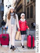 Купить «tourists girl and woman walking with baggage», фото № 28085397, снято 19 ноября 2017 г. (c) Яков Филимонов / Фотобанк Лори