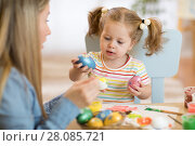 Купить «Happy time while painting easter eggs», фото № 28085721, снято 28 февраля 2020 г. (c) Оксана Кузьмина / Фотобанк Лори