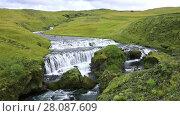 Купить «Stunning landscape with hills and a river flowing into the waterfall Skogafoss in Iceland», видеоролик № 28087609, снято 19 ноября 2017 г. (c) Алексей Кузнецов / Фотобанк Лори