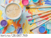 Купить «paints, brushes and cup of coffee on paper», фото № 28087769, снято 26 декабря 2017 г. (c) Майя Крученкова / Фотобанк Лори