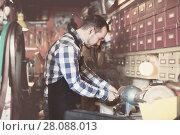 Купить «Male worker polishing buckle for belt», фото № 28088013, снято 23 июля 2018 г. (c) Яков Филимонов / Фотобанк Лори
