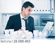 Купить «Businessman feeling thirsty in hot office», фото № 28088493, снято 20 апреля 2017 г. (c) Яков Филимонов / Фотобанк Лори