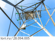 Купить «Inside view of the structure under power transmission tower. High voltage electric tower», фото № 28094005, снято 8 октября 2017 г. (c) FotograFF / Фотобанк Лори