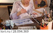 Купить «Caucasian woman artist drawing picture in art studio, tilt down video shot», видеоролик № 28094369, снято 23 января 2016 г. (c) Алексей Кузнецов / Фотобанк Лори