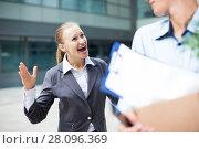 Купить «Irate woman is dismissing young manager for violating the job description», фото № 28096369, снято 15 июля 2017 г. (c) Яков Филимонов / Фотобанк Лори