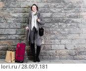 Купить «teenager girl with baggage in hood», фото № 28097181, снято 11 ноября 2017 г. (c) Яков Филимонов / Фотобанк Лори