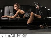 Купить «Gorgeous brunette in bdsm style lying on a sofa», фото № 28101081, снято 27 января 2018 г. (c) Гурьянов Андрей / Фотобанк Лори