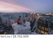 Купить «Man sits with camera on rooftop and shoots Tverskaya street in Moscow at morning», фото № 28102609, снято 30 июля 2016 г. (c) Losevsky Pavel / Фотобанк Лори