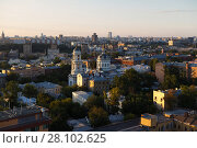 Купить «Church of St. Martin Confessor among residential buildings at sunny summer day in Moscow, Russia», фото № 28102625, снято 19 июля 2014 г. (c) Losevsky Pavel / Фотобанк Лори