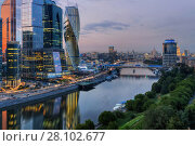Купить «MOSCOW - JUN 24, 2015: Moscow International Business Center and Bagration bridge at night. Investments in Moscow International Business Center was approximately 12 billion dollars», фото № 28102677, снято 24 июня 2015 г. (c) Losevsky Pavel / Фотобанк Лори